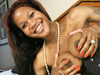 Ts ebony. Tranny Ebony exposing her big bouncy titties