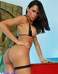 Yasmin. Hot brunette stripping for the camera