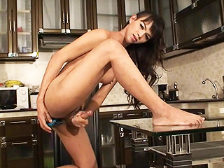 Maya. Exotic Maya toying and masturbating in the kitchen