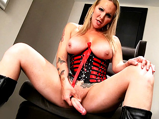 Candy Curvy shemale Candy stroking in tight lascivious corset.