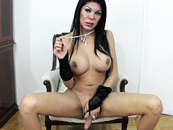 Andrea. Busty TS Andrea stroking her long stiff cock